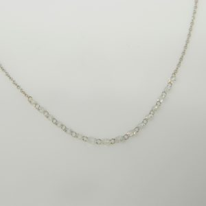18 Karat White Gold Mounted Necklace with 16 Aero Pierced Diamonds weighing 1.43cts
