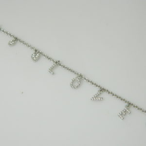 "18 Karat White Gold Straight Line Mounted ""Love"" 7.5'' Bracelet with 48 Round Cut Diamonds weighing 0.24ct tw."
