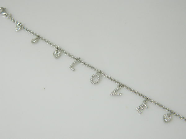 """18 Karat White Gold Straight Line Mounted """"Love"""" 7.5'' Bracelet with 48 Round Cut Diamonds weighing 0.24ct tw."""