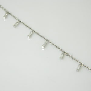 18 Karat White Gold Straight Line Mounted 7.5'' Bracelet with 9 Baguette Cut Diamonds weighing 0.47ct tw.