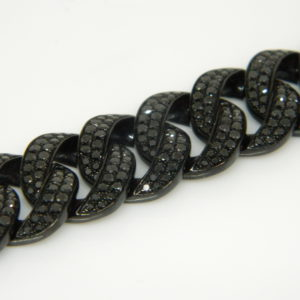 "18 Karat White Gold Straight Line Mounted 7.5"" Bracelet with 738 Round Cut Black Diamonds weighing 9.21cts."