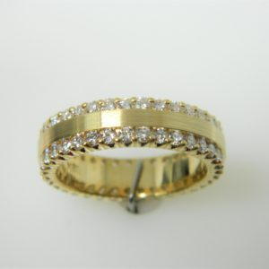 18 Karat Yellow Gold Band Mounted Ring with 70 Round Cut Diamonds weighing 1.59cts- Size 7.5