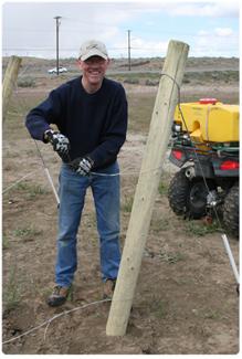 Richard Beightol installing a trellis