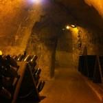 Riddling racks in cave at Taittinger