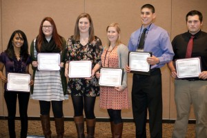 WSU viticulture and enology students with their scholarships at the 2015 Washington Association of Wine Grape Growers annual conference. Pictured from left to right: Bhanu Priya Donda, Madeleine Barcellona, Caroline Merrell, Allison Baker, Zachary Cartwright, Braden Mortensen (Central Washington University).