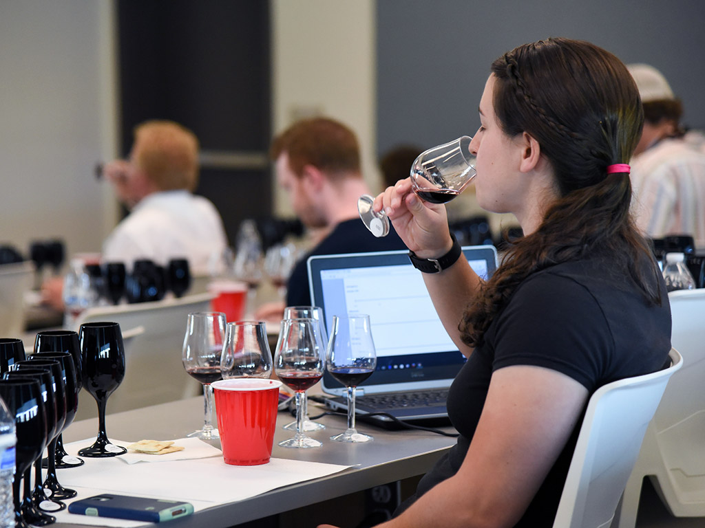 Student Sampling Wine in Enology Class