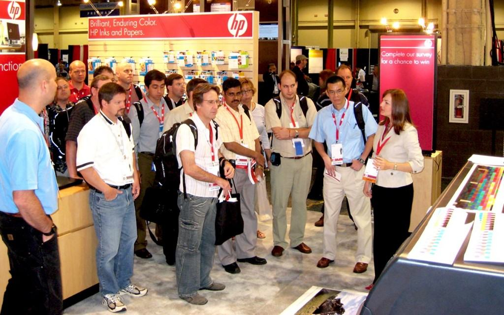 Karen Multer leads technology tours through a crowded HP booth a SAPPHIRE in Orlando