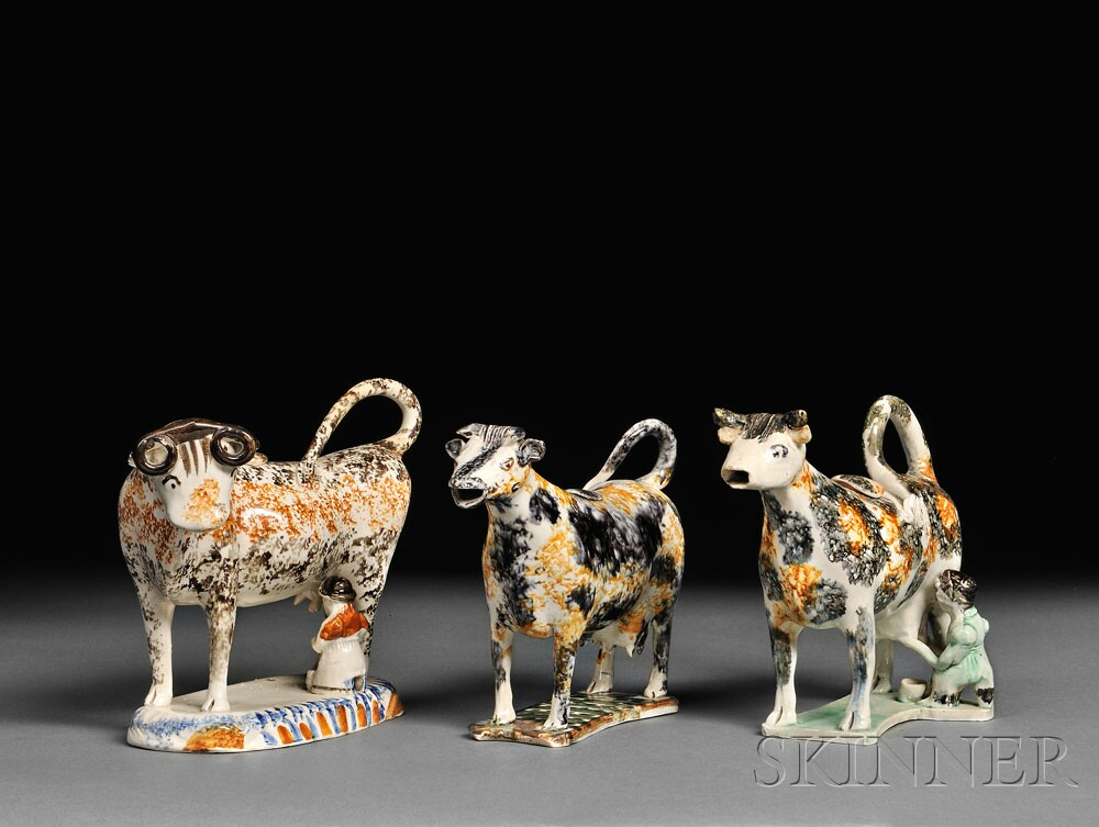 Examples of Staffordshire Earthenware Cow Creamers (Lots 1270, 1102, and 1269, estimates $500-$700 and $400-$600)
