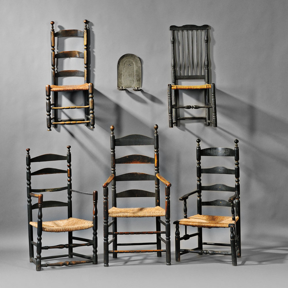 Antique chairs from 18th and 19th century New England with an embossed tin candle sconce