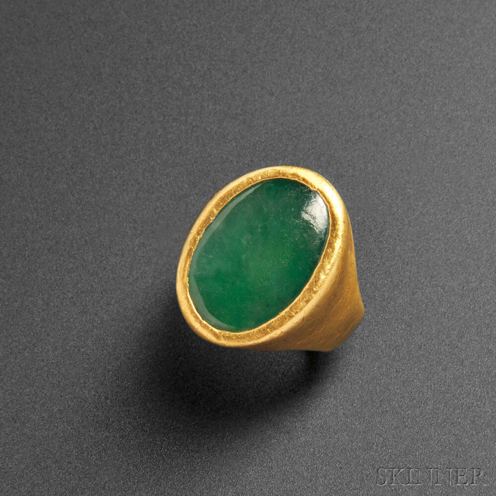 Gold Signet Ring with Cabochon Jadeite Inset, China, 20th century (Lot 471, Estimate $2,000-$3,000)