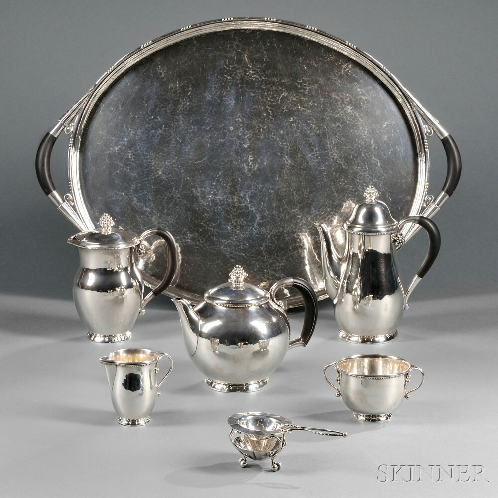 Five-piece Georg Jensen Sterling Silver Tea and Coffee Service with Associated Sterling Silver Tray and Tea Strainer with Stand, Copenhagen, Denmark, second quarter 20th century (Lot 57, Estimate $8,000-$12,000)