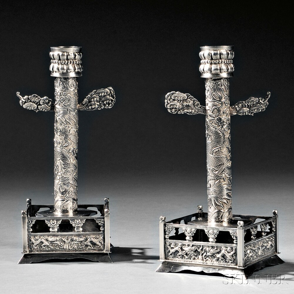 Pair of Chinese Export Silver Candlesticks, late 19th century (Lot 63, Estimate $1,200-$1,800)