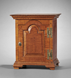 Chester County, Pennsylvania carved tiger maple spice chest, c. 1780, sold for $23,700 at Skinner in 2010