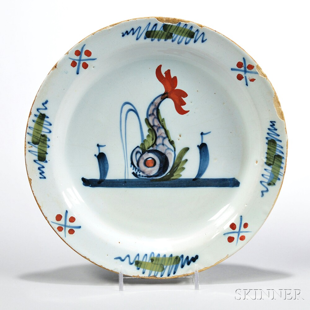 Tin-glazed Earthenware Dolphin Plate,  England, c. 1730 (Lot 189, Estimate $1,500-$2,500)