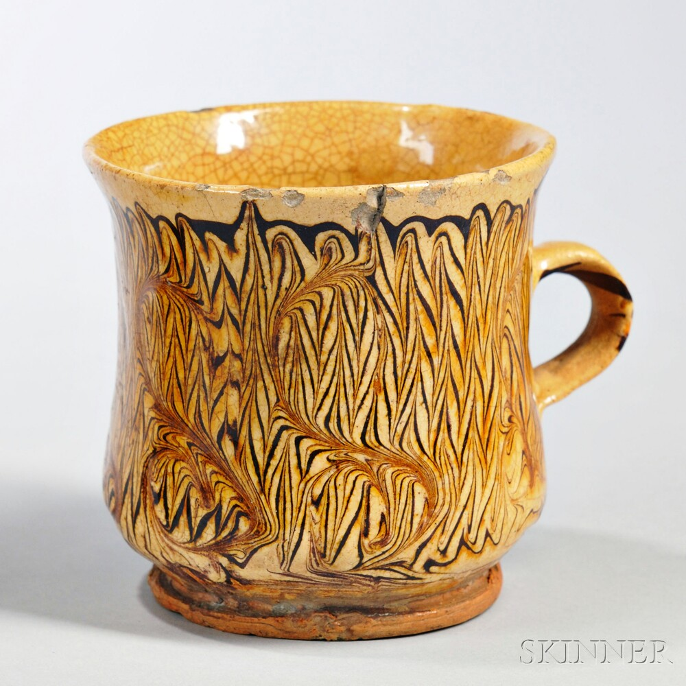 Staffordshire Combed Slipware Drinking Cup, England, c. 1690-1700 (Lot 217, Estimate $2,500-$3,500)
