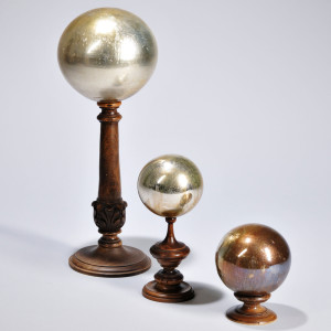 Three Gilt Glass Spheres, late 19th century (Lot 1010, Estimate $600-$800)