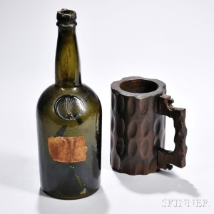 Carved Mug from the Maststep of the America, and an Early Blown Glass Bottle, early and mid-19th century (Lot 1142, Estimate $1,500-$2,500)
