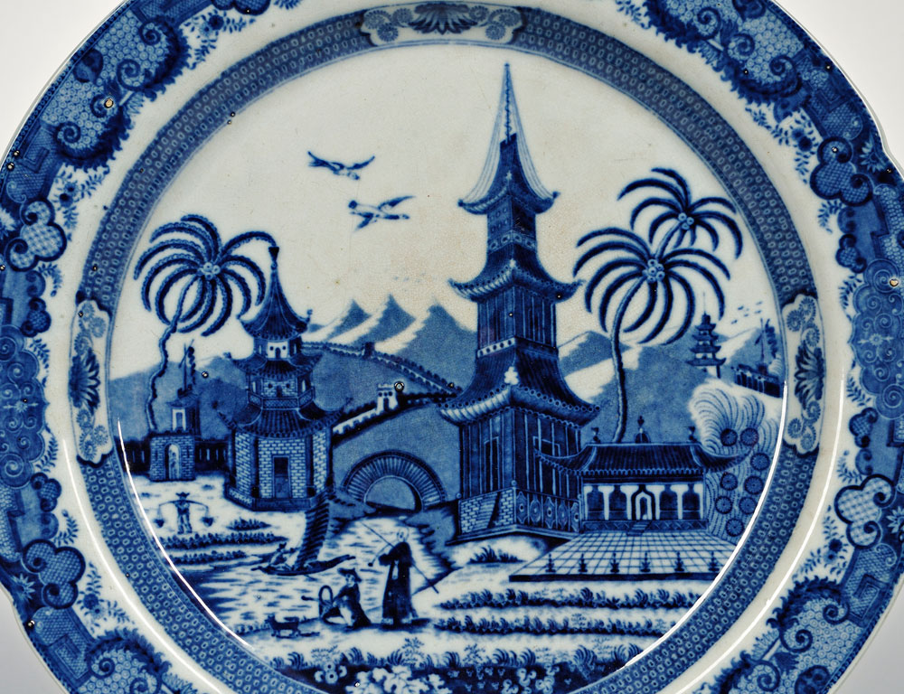 [Detail] Leeds Pottery Blue and White Pearlware Charger, England, early 19th century (Estimate $150-$250)
