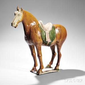 Sancai-glazed Caparisoned Horse, China, Tang dynasty (Lot 57, Estimate $15,000-20,000)