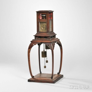 Japanese Dai Tokei or Lantern Clock on Wooden Stand, 19th century (Lot 702, Estimate: $5,000-7,000)