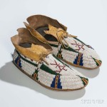 Cheyenne Beaded Hide Pictorial Moccasins, c. last quarter 19th   century (Lot 31, Estimate: $2,500-3,500)