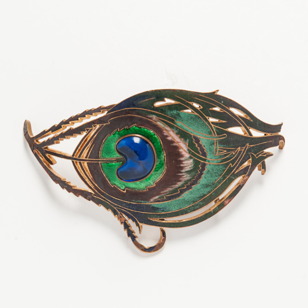The Woman About Town- Piel Freres Art Nouveau Enameled Peacock Buckle (Lot 1031, Estimate: $400-600)- This colorful buckle would add a simple elegance and touch of fun to any wardrobe.