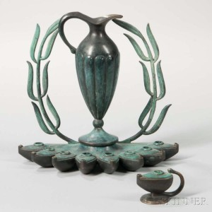 Pal-Bell Patinated Bronze Hanukkah Lamp, designed by Maurice Ascalon, Jerusalem, c. 1950. Recognizable with the references to Roman lamps and the patination of ancient bronzes the design is closely associated with early statehood.