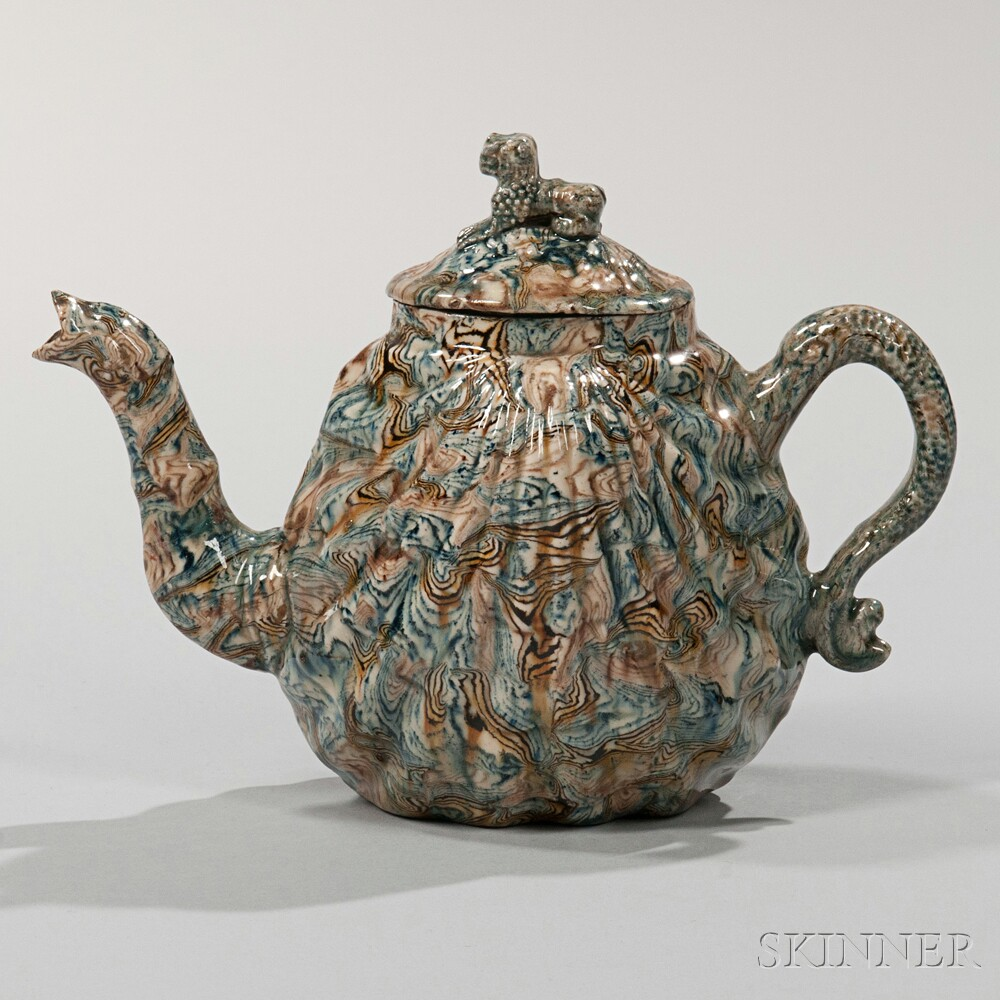 Staffordshire Solid Agate Pecten Shell Teapot and Cover, England, c. 1750 (Lot 33, Estimate $1,000-1,500)