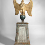 Carved Giltwood Eagle Figure on a Paint-decorated Pedestal Cabinet, 19th century (Lot 500, Estimate $12,000-15,000)