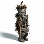 Songye-style Carved and Feathered Nkisi Power Figure [Lot 1248]