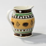 Mocha and Slip-decorated Pitcher, England, early 19th century (Lot 378, Estimate $1,500-2,500)