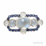 Platinum, Moonstone, and Montana Sapphire Brooch, Tiffany & Co., c. 1910 (Lot 325, Estimate $8,000-10,000)