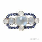 Platinum, Moonstone, and Montana Sapphire Brooch, Tiffany & Co., c. 1910 (Lot 325, Estimate $8,000-10,000)