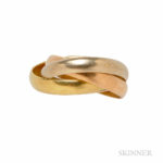 18kt Tricolor Gold Trinity Ring, Le Must de Cartier, France (Lot 1024, Estimate $400-600)