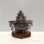 Chinese, amethyst tripod covered censer with dragon handles.