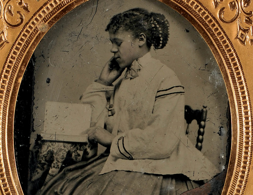 Cased Tintype Depicting an African American Young Lady Reading (Lot 143)