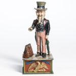 Cast Iron 'Uncle Sam' Mechanical Bank, Shepard Hardware Company, Buffalo, New York, late 19th century, (Lot 1257, Estimate: $800-1,200)