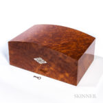 Cartier Humidor in Burl Vavona Figured Wood and 'Platinum' Finish, late 20th century (Lot 3001, Estimate: $800-1,200)