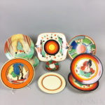 Twelve Clarice Cliff-decorated Newport Pottery Plates and Dishes (Lot 1187, Estimate: $200-400)