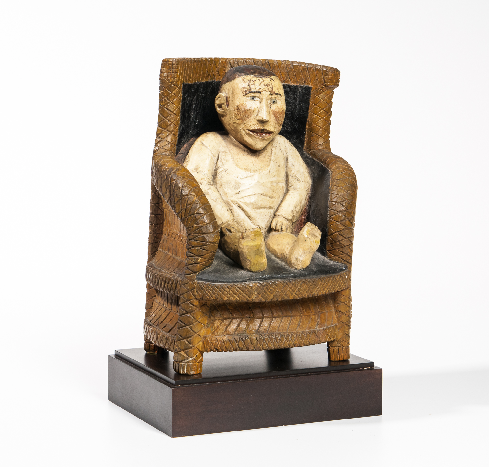 Carved and Painted Baby in a Chair Figure, possible Upstate New York, late 19th century (Lot 64, Estimate: $5,000-7,000)