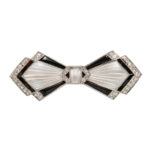 Art Deco Platinum, Rock Crystal, Onyx, and Diamond Bow Brooch, Tiffany & Co. (Lot 1063, Estimate: $1,500-2,000)
