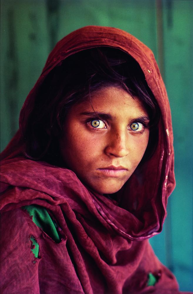 Steve McCurry (American, b. 1950), Afghan Girl (Sharbat Gula), Refugee Camp, Pakistan,  1984, printed later, chromogenic print (Lot 139, Estimate: $8,000-12,000)