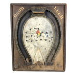 Paint-decorated Pine Good Luck Horseshoe-form Board (Lot 469, Estimate: $300-500)