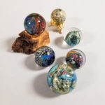 Six Josh Simpson Glass Planet Marbles (Lot 1299, Estimate: $200-400)