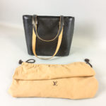 Louis Vuitton Stockton Noir Bag, with embossed logo, dust cover, and original receipt. (Lot 2321, Estimate: $200-300)