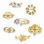 Group of Art Nouveau Gold Floral Brooches, most enameled, set either with diamonds or pearls, wd. 1 3/8 in., total 12.5 dwt. (Lot 2040, Estimate: $400-600)