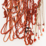 Group of Coral Jewelry, including bead necklaces, bracelets, and carved pendants. (Lot 2007, Estimate: $400-600)
