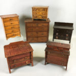 Six Walnut, Maple, and Pine Miniature Bureaus (Lot 227, Estimate: $200-300)