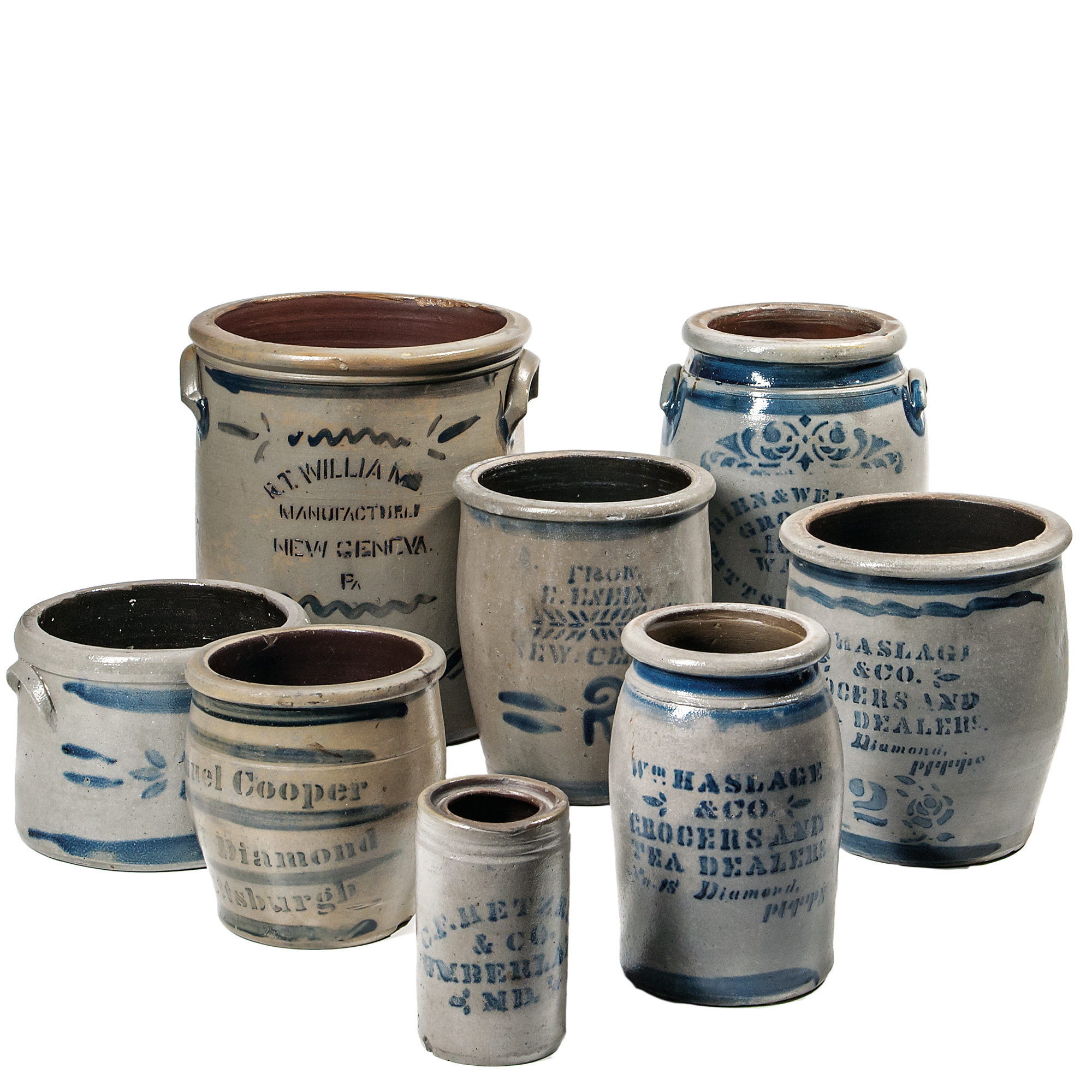 Eight Cobalt-decorated Advertising Crocks and Jars (Lot 1566, Estimate: $600-800)