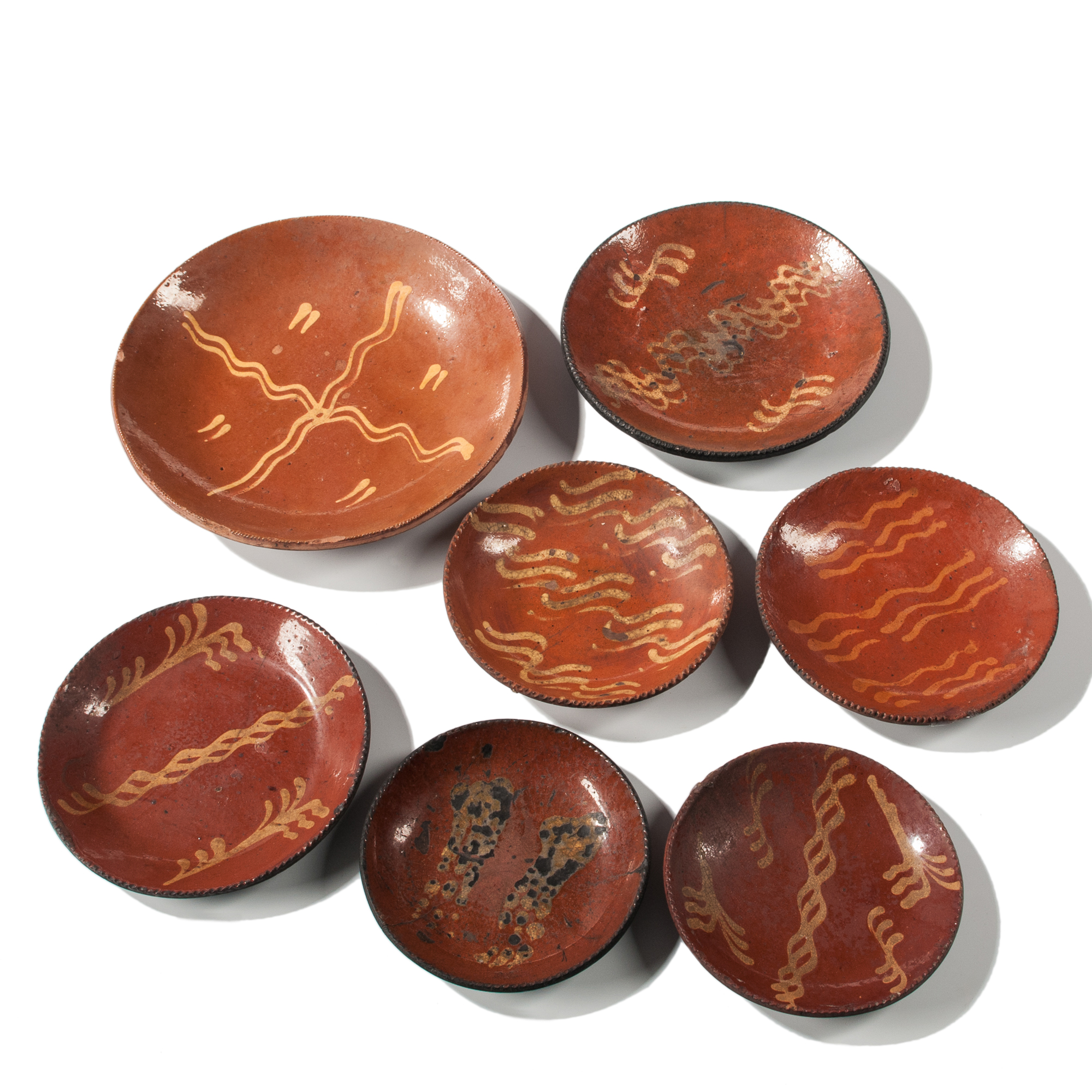 Seven Slip-decorated Redware Plates (Lot 1275, Estimate: $600-800)